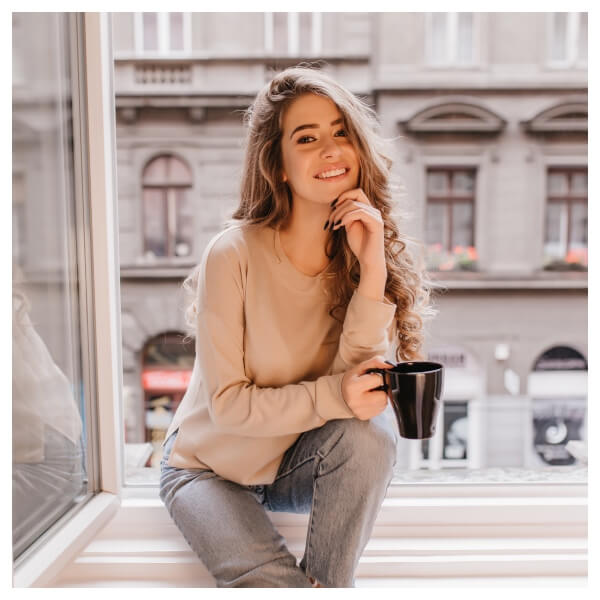 Bright Indoor Lightroom Preset Filters woman with coffee and in window after