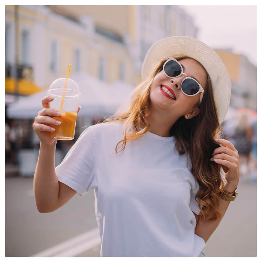 Bright and Airy Lightroom Preset Filters woman with a drink and sunglasses and had before
