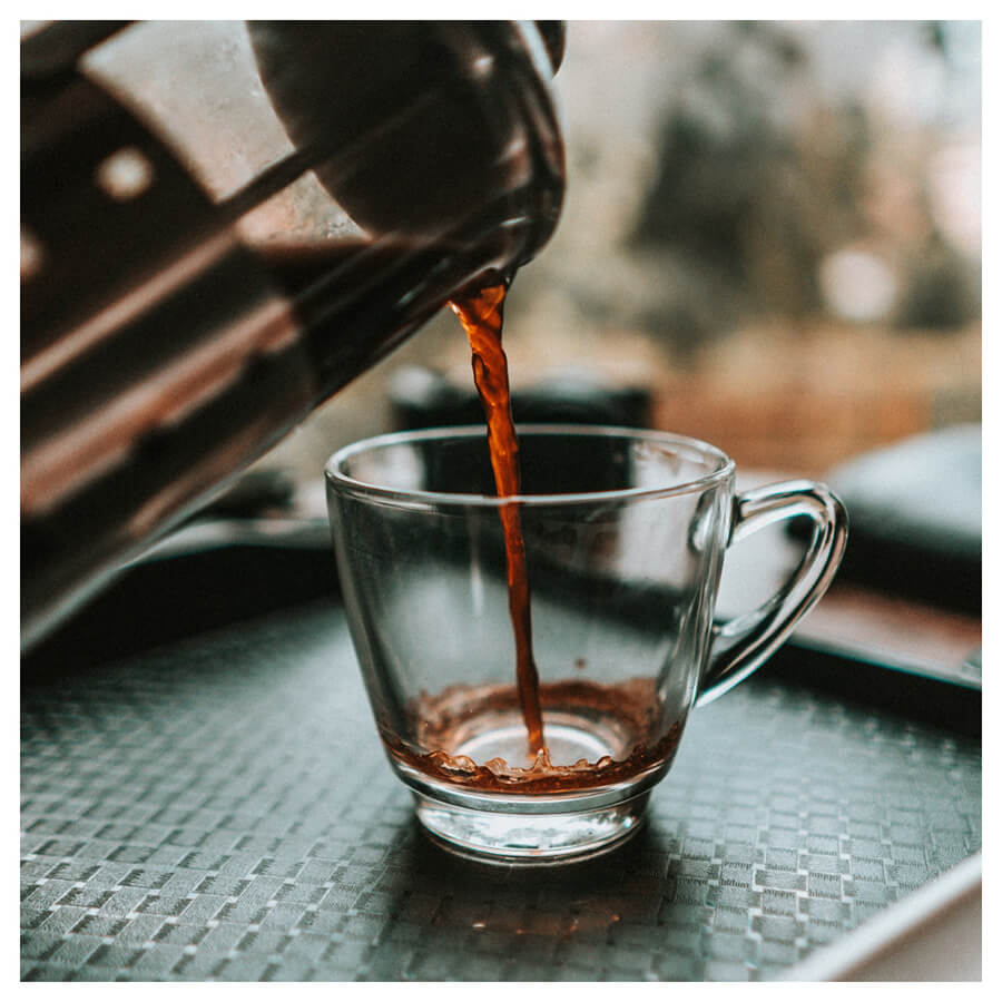 Moody For Men Lightroom Preset coffee in a cup from Pixgrade before