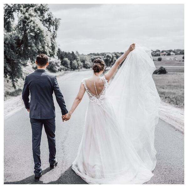White Wedding Lightroom Preset filters bride and bridegroom hand in hand after