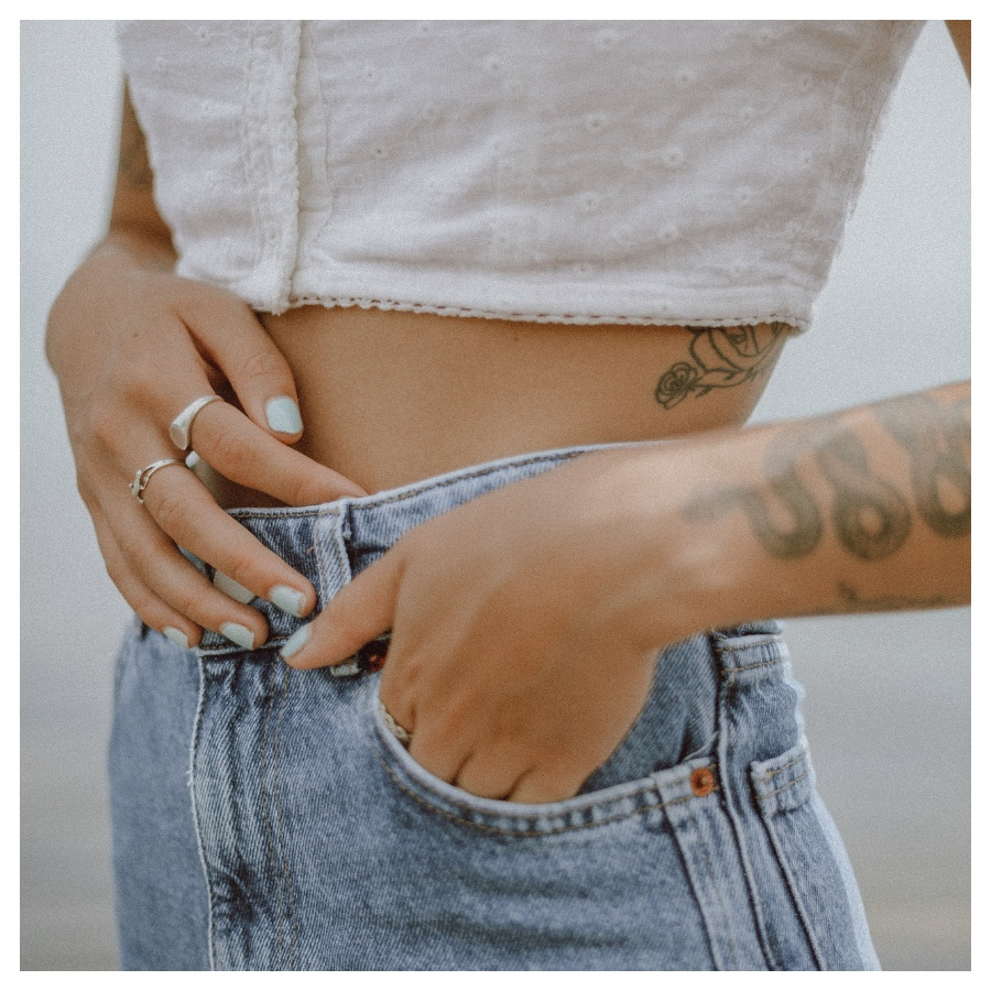 girl snake tattoo jeans after